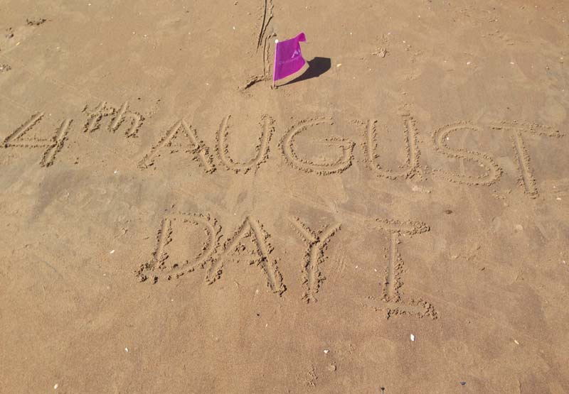 4th August written in the sand Camber Sands