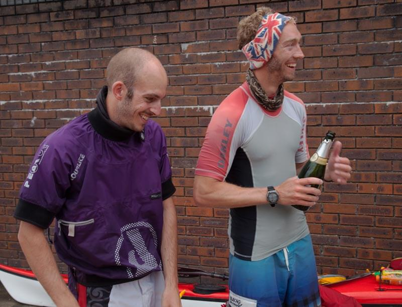 Anthony Klokkou and Luke Quilter of Sleeping Giant Media at finish of kayaking challenge