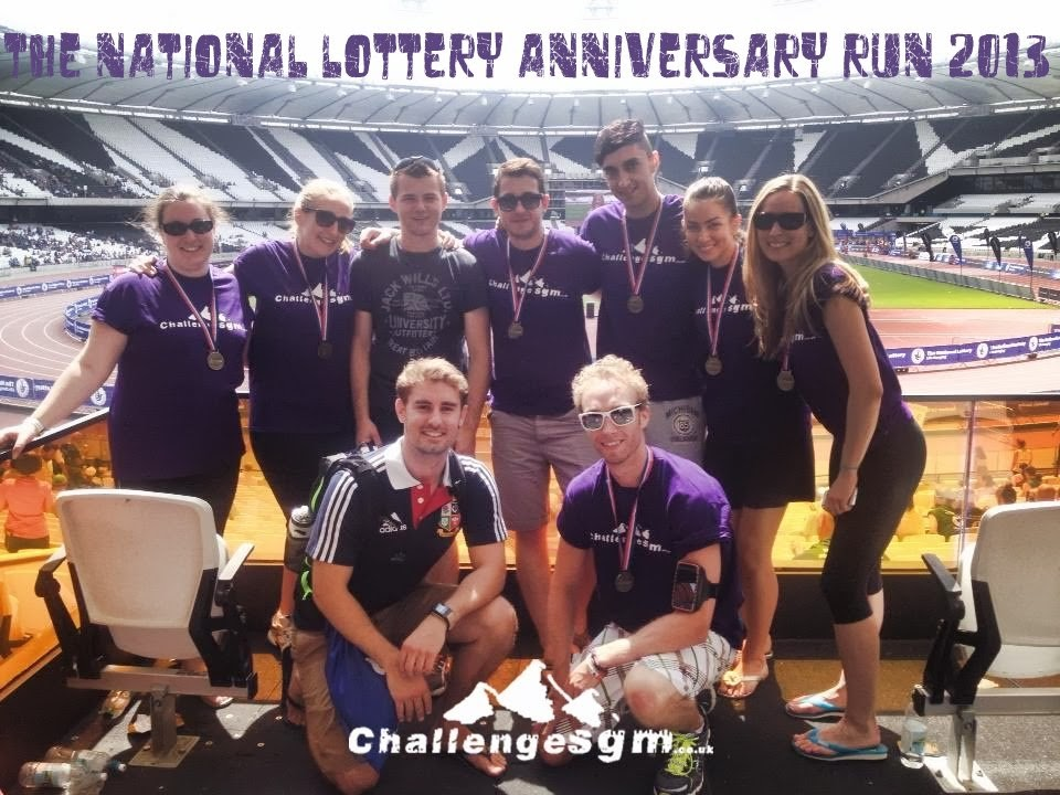 Sleeping Giant Media Challenge SGM team inside the Olympic Stadium after the National Lottery Anniversary Run