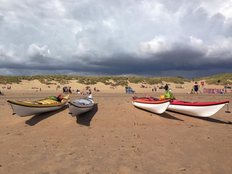 Kayaks on the beach at Camber