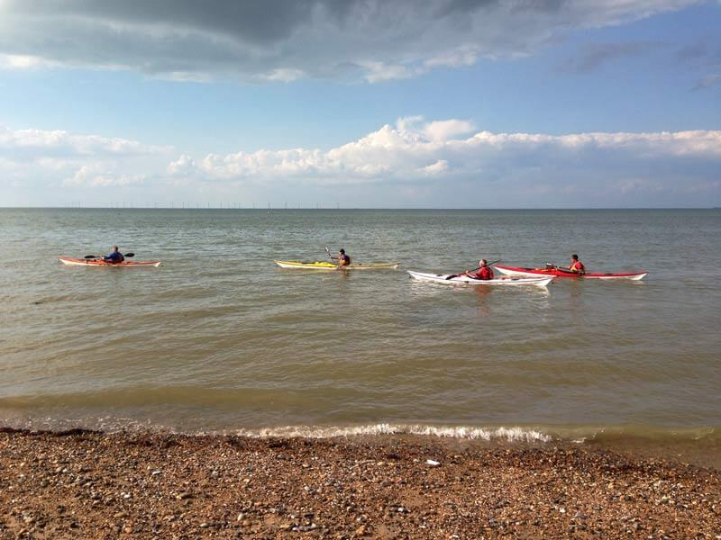 Kayaks just off the beach Herne Bay