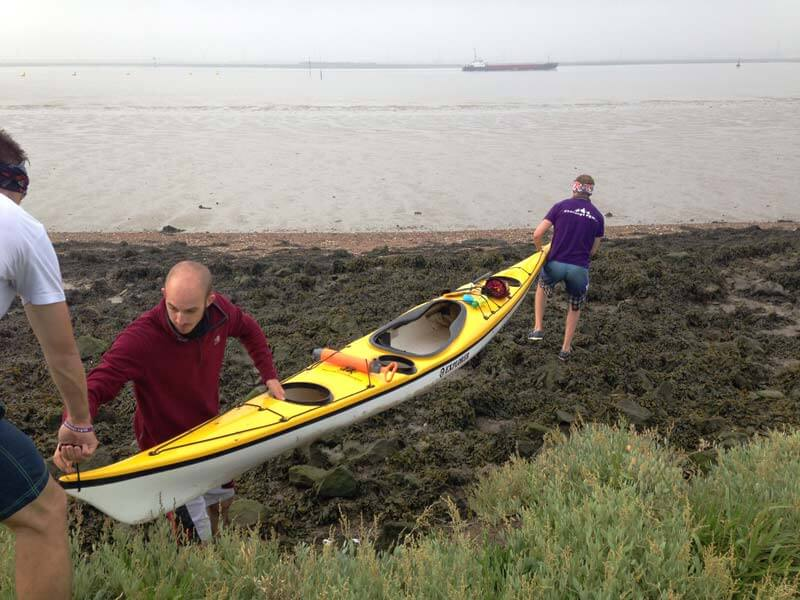 Lifting kayak over mud Tilbury morning