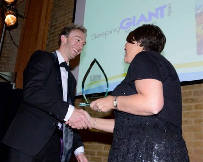 Luke Quilter of Sleeping Giant Media accepting Business of the Year Kent Invicta Chamber of Commerce Business Awards 2014