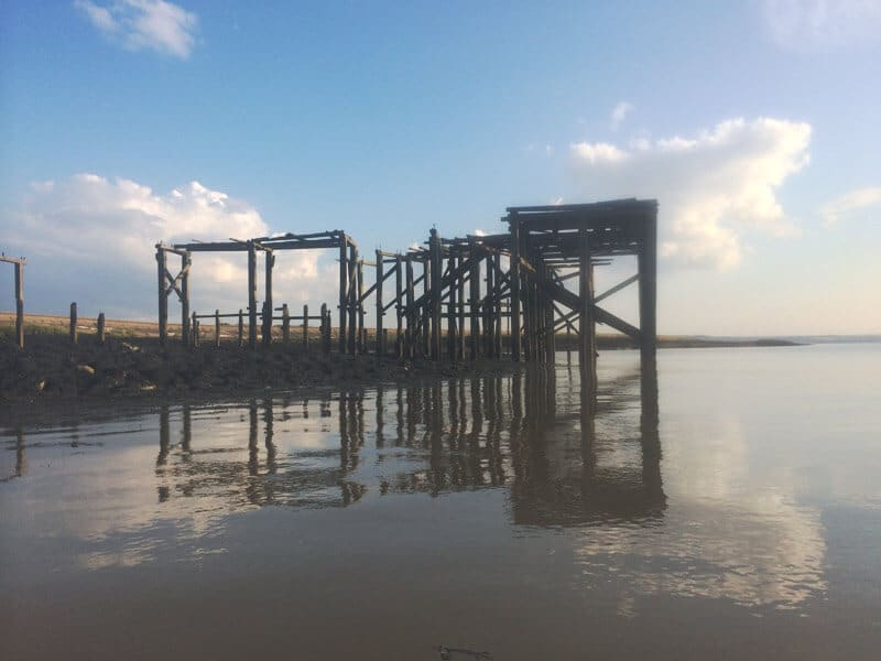 Wooden structure on bank of the Thames estuary Kent
